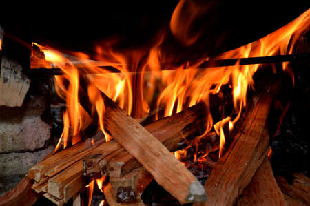 firewood in the fireplace hearth cooking photo