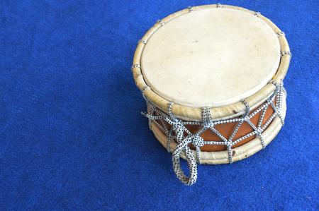 blue carpet: traditional drum on the blue carpet Stock Photo