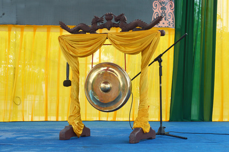 gong: traditional golden gong with dragon ornaments