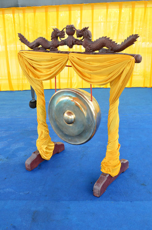 traditional golden gong with dragon ornaments photo