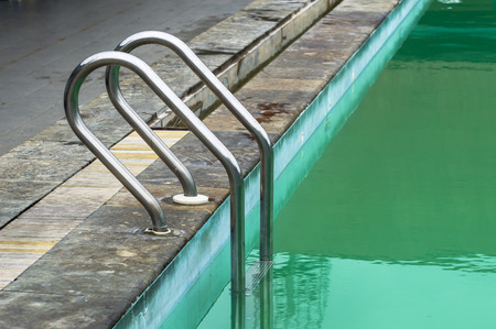 alluminiumc staircase in the pool photo