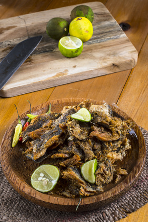 snake head fish: Bette bale bolong rakko an Indonesian traditional side dish is dried snakehead fish fry crushed and mixed with chili and lemon