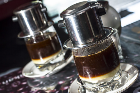 Coffee dripping in vietnamese style at a cafe Imagens
