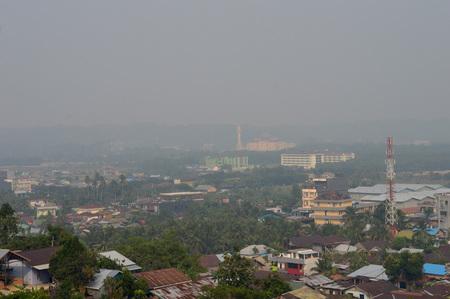 cinta: TARAKAN, INDONESIA - SEPT, 10, 2015 :the view from the top of the  bukit cinta  Tarakan city cloaked in thick smog on Sept 10, 2015  in Tarakan, Indonesia Editorial