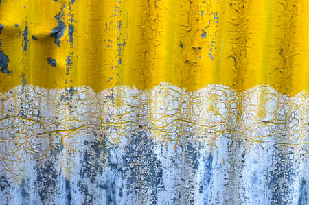grooved: old yellow zinc wall background Stock Photo