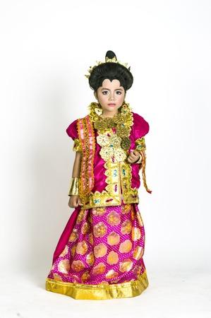 identidad cultural: asian little girl wear Bugisnese traditional dresses on studio shoot Foto de archivo