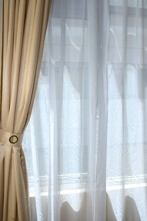 yellow tassel: gold curtain on the window with white layer Stock Photo