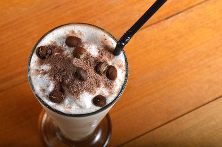 cappucino: cappucino milkshake drink on wooden board Stock Photo