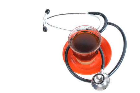 instrumental medico: stethoscope with a cup coffee  on white background