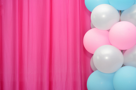 coloured background: balloons frame on blank pink curtain  background Stock Photo