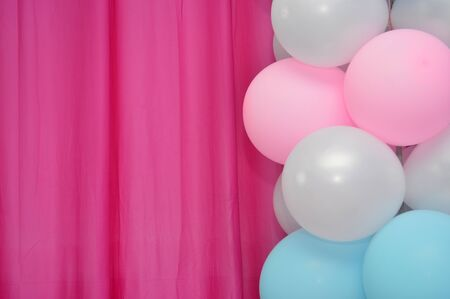 blue background: balloons frame on blank pink curtain  background Stock Photo
