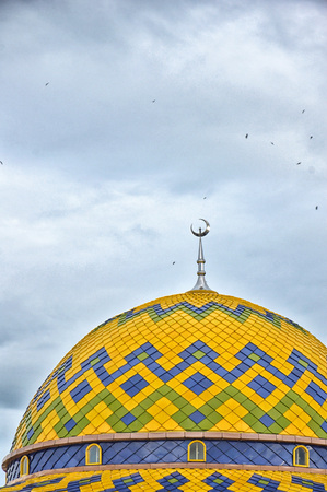 prayer tower: the dome of mosque against blue sky