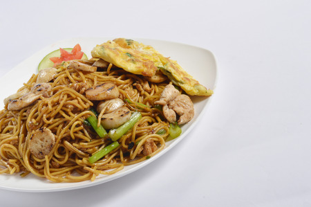 rice plate: fried noodles on white table Stock Photo