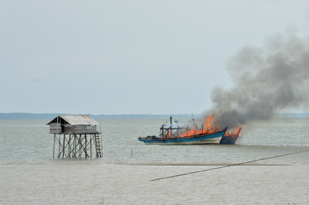 acts: Tarakan,Indonesia-April 5, 2016. two Malaysian fishing boats as evidence to be detonated by Marine Police for acts of illegal fishing in Indonesian waters