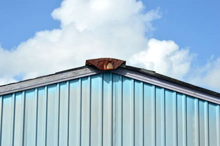 house roof against blue sky