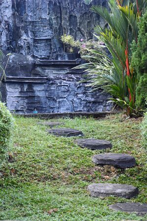 curvaceous: a curvaceous foothpath made of concrete blocks at a park Stock Photo