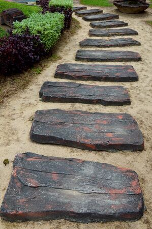 curvaceous: a curvaceous foothpath made of concrete blocks on the garden