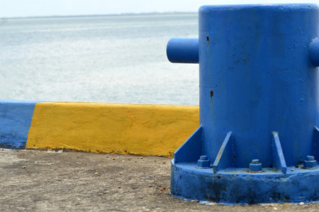 mooring: blue mooring bollard  on seaport Stock Photo