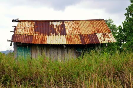 old house in the grove of scrub grass Stock Photo