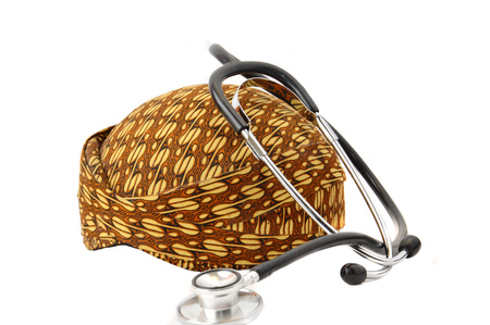 javanese: blangkon a traditional hat Javanese men with stethoscope on white background
