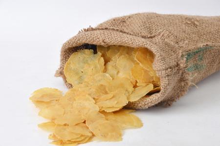 melinjo in burlap sacks on white background Stock Photo