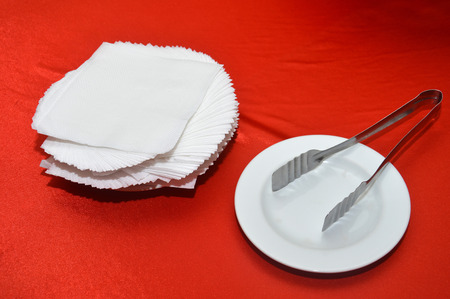 white tissues on red table Stock Photo