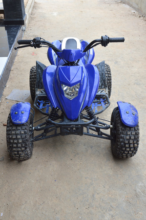 off road biking: blue ATV motorcycle beach