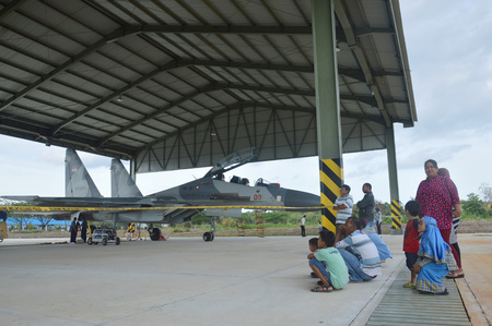 cornerstone: TARAKAN, INDONESIA. March, 6,  2017. static show Sukhoi aircraft of the Indonesian Air Force on cornerstone of the air force shelter Tarakan City Indonesia Editorial