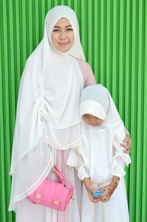 Asian mother and daughter Muslims