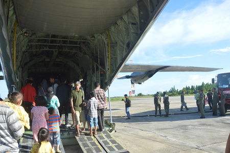 airfield: TARAKAN, INDONESIA. March, 10,  2017. Hercules military airplane at the static show Sukhoi aircraft of the Indonesian Air Force on cornerstone of the air force shelter Tarakan City Indonesia