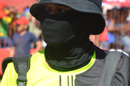 TARAKAN, INDONESIA. 21th May 2017. A journalist with black mask at motoprix national championship oin the non-permanent circuit Datu Adil Tarakan Stadium