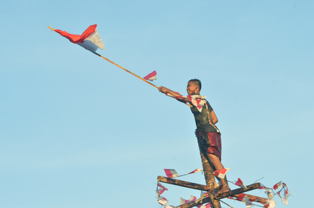 TARAKAN, INDONESIA. August, 27, 2017, Areca climbing competition In order to enliven the celebration of the 72nd anniversary of the Indonesian republic in Tarakan City Editorial