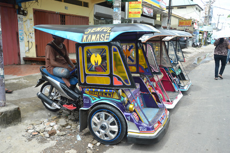 MAKASSAR, INDONESIA. 7th January 2014. Bentor a combination of pedicabs and motorcycles  at Makassar Indonesia