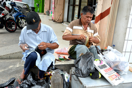 TARAKAN, INDONESIA - 26th March 2016 : two cobbler on the storefront