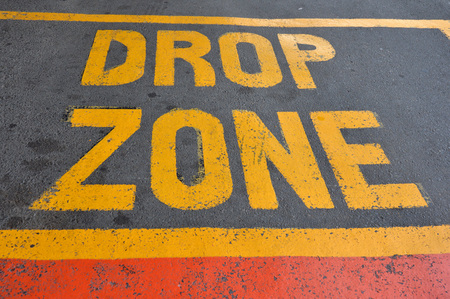 yellow drop zone text on the asphalt