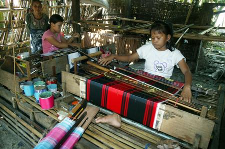 SENGKANG, INDONESIA. 30th June 2009. Buginese women traditional silk cloth weavers