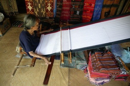 TORAJA, INDONESIA. 1st July 2009. Toraja old woman traditional cloth weavers Editorial