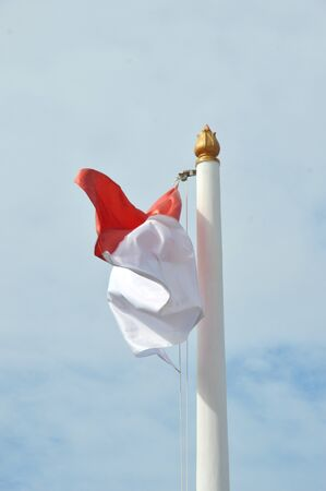 Indonesias flag against blue sky