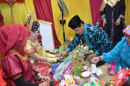 TARAKAN, INDONESIA - 19th March  2016 : Mappacci the traditional wedding ceremony of the bugisnese Indonesian the prospective bride the day before the wedding Editorial