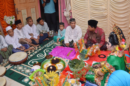 TARAKAN, INDONESIA - 9th January 2016 : Mappacci the traditional wedding ceremony of the bugisnese Indonesian the prospective bride the day before the wedding Editorial
