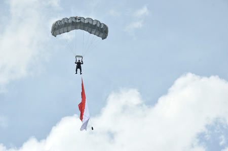 TARAKAN, INDONESIA, 17 DEC 2017 : attraction skydiving in the sky Iraw Tengkayu Festival at Amal Beach Tarakan, Indonesia, in the framework of the 20th anniversary of the city Editorial