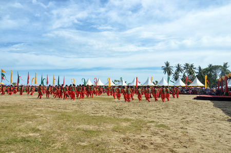 TARAKAN, INDONESIA, 17 DEC 2017 : Colossal dance of  Iraw Tengkayu Festival at Amal Beach Tarakan, Indonesia, in the framework of the 20th anniversary of the city Editorial