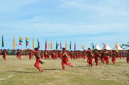 TARAKAN, INDONESIA, 17 DEC 2017 : Colossal dance of  Iraw Tengkayu Festival at Amal Beach Tarakan, Indonesia, in the framework of the 20th anniversary of the city Editorial