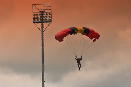 TARAKAN, INDONESIA - APRIL ,20, 2017, : The parachute attraction at the opening ceremony of the Integration Training of Military Academy Taruna and the Academy of Domestic Government in Tarakan Indonesia