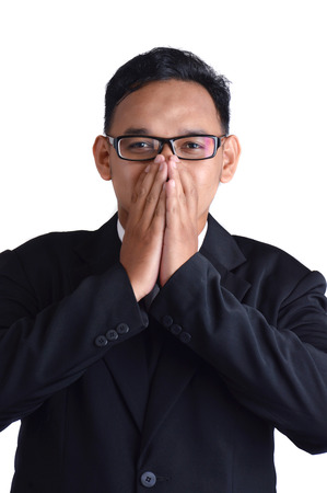 asian male businessman shut up on white background Banco de Imagens