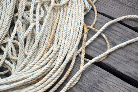 roll of old rope on the wooden floor 免版税图像
