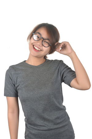portrait of Asian teenage girl wearing glasses and dressed in a gray shirt