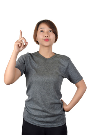 Asian girl points her index finger isolate on white background