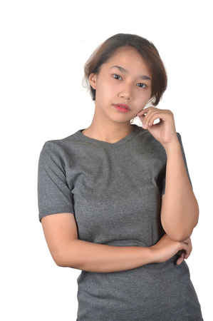 portrait of Asian teenage girl dressed in a gray shirt