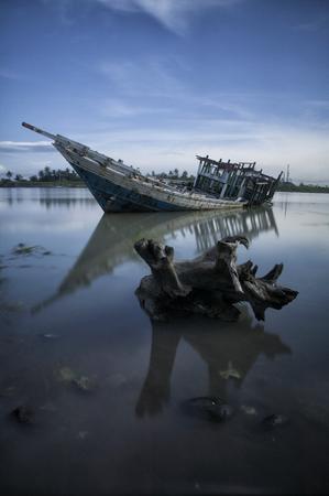 shipwreck of phinisi ship - Traditional wooden sailing ships at beach